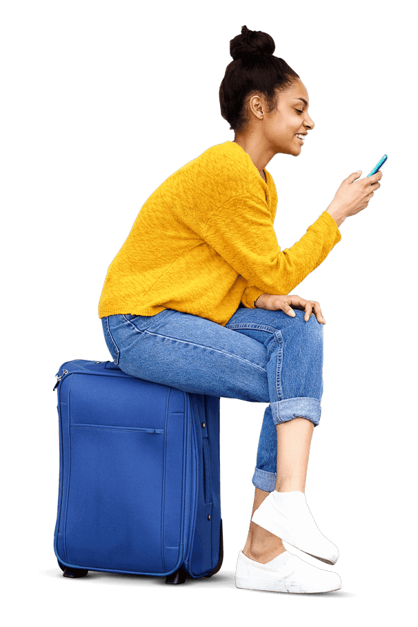 Lady sitting on suitcase